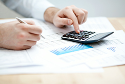 accountant working on a calculator